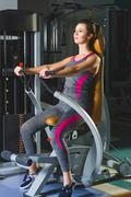 Stock Photo of sporty young woman doing exercise at the gym