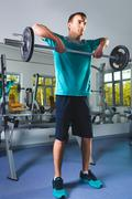 Muscular Man Lifting Deadlift In The Gym Stock Photos