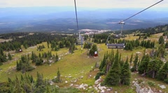 Downloading on a Ski Resort Chairlift in Summer - stock footage