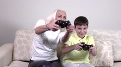 Mother and child playing a video game Stock Footage