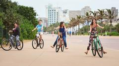Family riding bicycles and having fun together Stock Photos