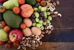 Healthy Diet with fresh fruit, eggs, nuts and vegetables. - stock photo