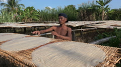 Drying rice pancakes near small noodle factory in Vietnam, Asia - stock footage