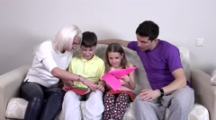 Happy big family makes from colored paper planes Stock Footage