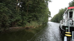 View from a boat of the vegetation along the river Stock Footage
