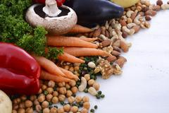 Vegetarian food vegetables, nuts and legumes. Stock Photos