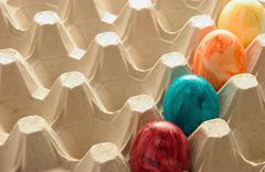 Colourful eggs in carton Stock Photos