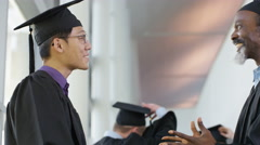 4K Happy group of mature students on graduation day, 2 men smile to camera - stock footage