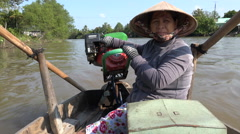 Traditional bamboo conical hat, woman sailing Mekong Delta, Vietnam, Asia Stock Footage