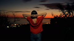 Stock Video Footage of Woman stretching her arms and admire sunset