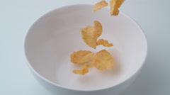 Corn flakes in a bowl. Slow Motion. Stock Footage