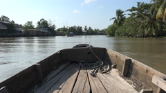 Sailing over a river on a wooden boat, in the Mekong Delta in Vietnam - stock footage