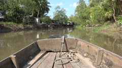 Sailing a wooden rowing boat through the Mekong backwaters in Vietnam Stock Footage