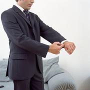 Man adjusting his cuffs Stock Photos