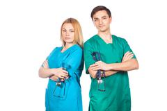 Healthcare and medical concept - two doctors with stethoscopes Stock Photos