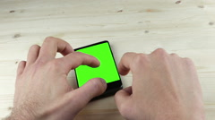 Man hands using a smart phone for write text messaging with chroma key green Stock Footage
