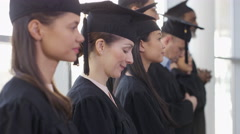 4K Happy group of mature students on graduation day, 1 woman smiles to camera - stock footage
