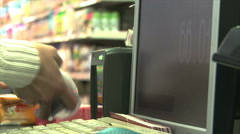 Shop worker hands at food products cashdesk checkout in supermarket Stock Footage