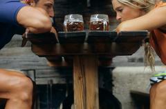 Couple sat outside a pub - stock photo