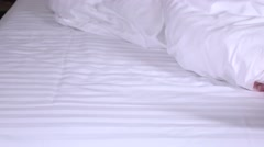 Four feet in a white bed, closeup - stock footage