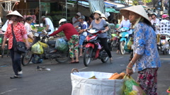 Traditional food market scene, woman selling bread in Vietnam, Southeast Asia Stock Footage