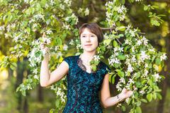 Stock Photo of Spring girl portrait. Asian woman smiling happy on sunny summer or spring day