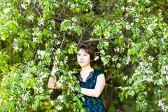 Spring girl portrait. Asian woman smiling happy on sunny summer or spring day Stock Photos