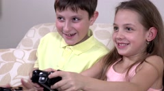Happy children playing a video game - stock footage