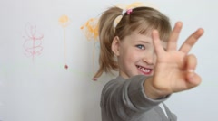 """Smiling little girl showing three fingers of sign """"OK"""" Stock Footage"""