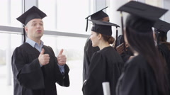 4K Happy group of mature students on graduation day, 1 woman smiles to camera. - stock footage