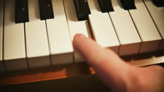 Stock Video Footage of Man Playing Piano Close Up on Hand in Slow Motion