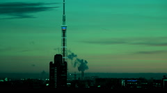 Fantastic colored cityaerial view with communication tower, clouds. - stock footage
