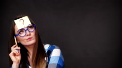 Woman thinking question mark on her head 4K Stock Footage