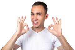 Brunette man with brackets - stock photo