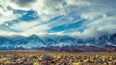 Time Lapse - Clouds Moving Over Snowy Mountain Ranges Stock Footage