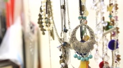 hand choosing necklace - stock footage