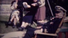 1947: US Navy admiral served afternoon cocktail at outdoor party. - stock footage
