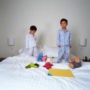 Unhappy young boys at bedtime Stock Photos