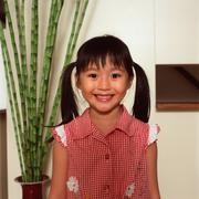 Asian girl with pigtails - stock photo