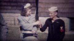 1947: US Navy ensign toasts cocktail women flirts outdoor sun. Stock Footage