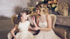 Mother makes up lips to daughter and kisses Stock Footage