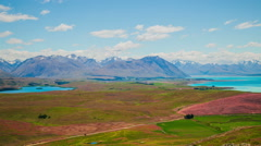 Time Lapse - Ariel View Lake Tekapo with Mountain Range and Beautiful Clouds - stock footage