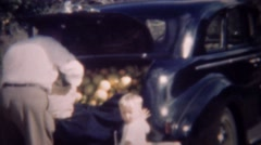 1947: Man packing car truck with orange fruit filling it up. Stock Footage