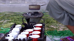 Coffee beans being roasted over charcoal for coffee ceremony - stock footage