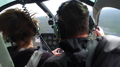 Helicopter inside, view from cockpit. Flying over Big Island lava field Stock Footage