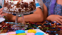 Cute siblings celebrating their birthday with their family - stock footage