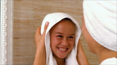 Cute mother and daughter in the bathroom Stock Footage