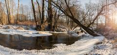 Frozen river in winter wonderland - stock photo