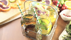 Detox citrus infused water as a refreshing summer drink. Stock Footage