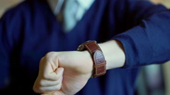 Man checking his wristwatch and set time while standing - stock footage
